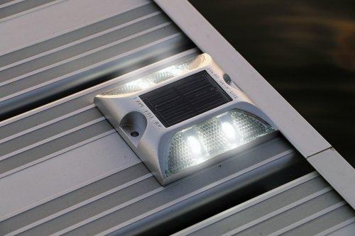 white solar dock light on aluminum dock